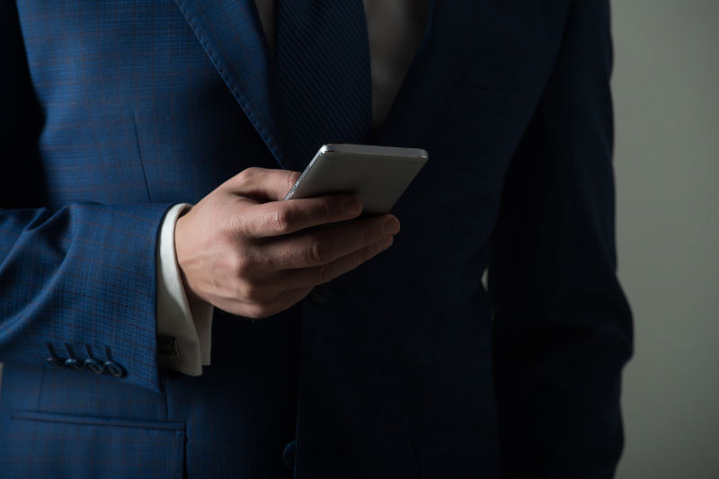 Close Up of Business Man Holding a Cell Phone